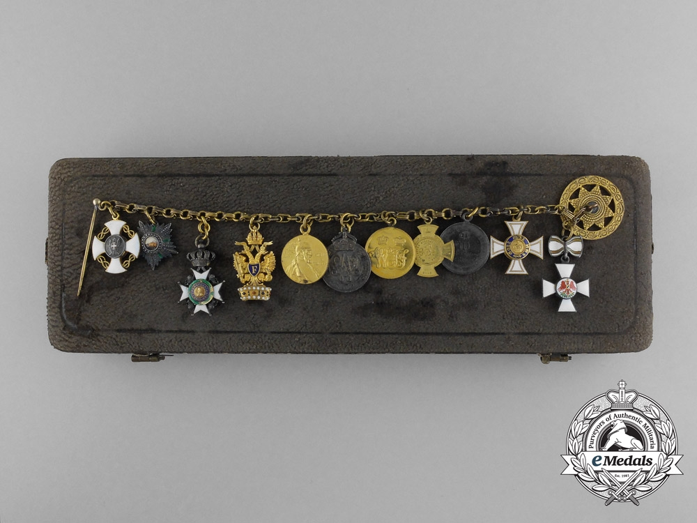 eMedals-A European and Iranian Miniature Group of Eleven with Case
