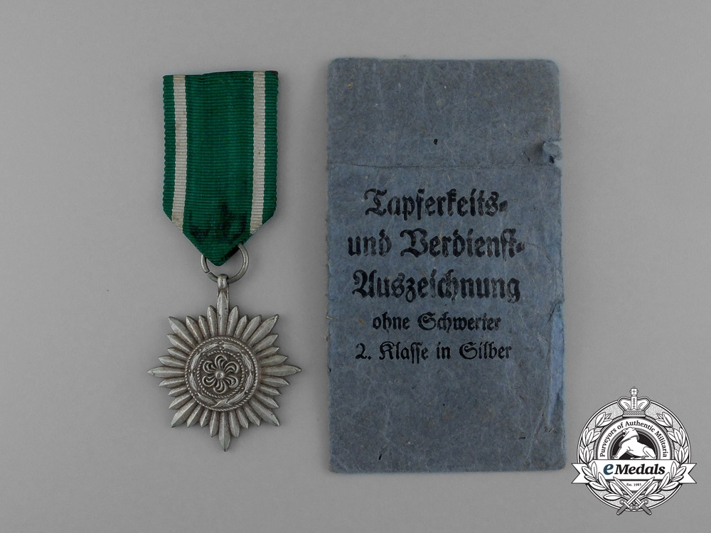 eMedals-An Austrian Made Silver Grade Ostvolk Merit Medal in its Original Packet of Issue by Rudolf Souval