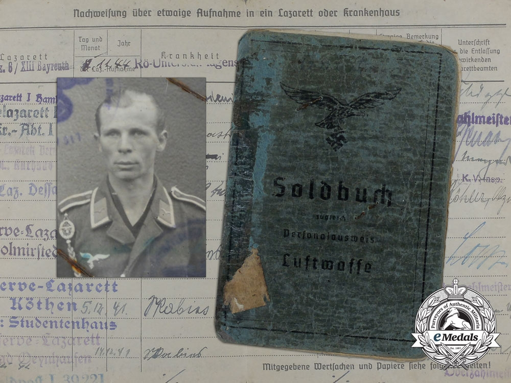 eMedals-A Soldbuch & Luftwaffe ID document to Ernst Quint; Fighter Wing 2, 11th Squadron