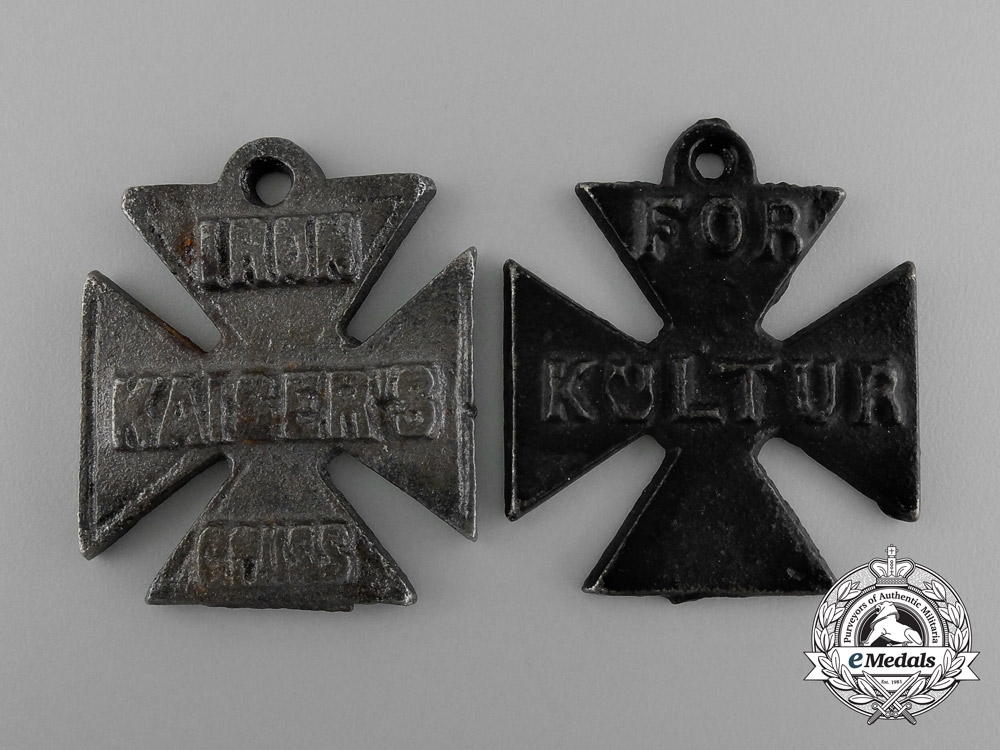 eMedals- A Grouping of Two First War British Anti-German Propaganda Medal Against German Excesses