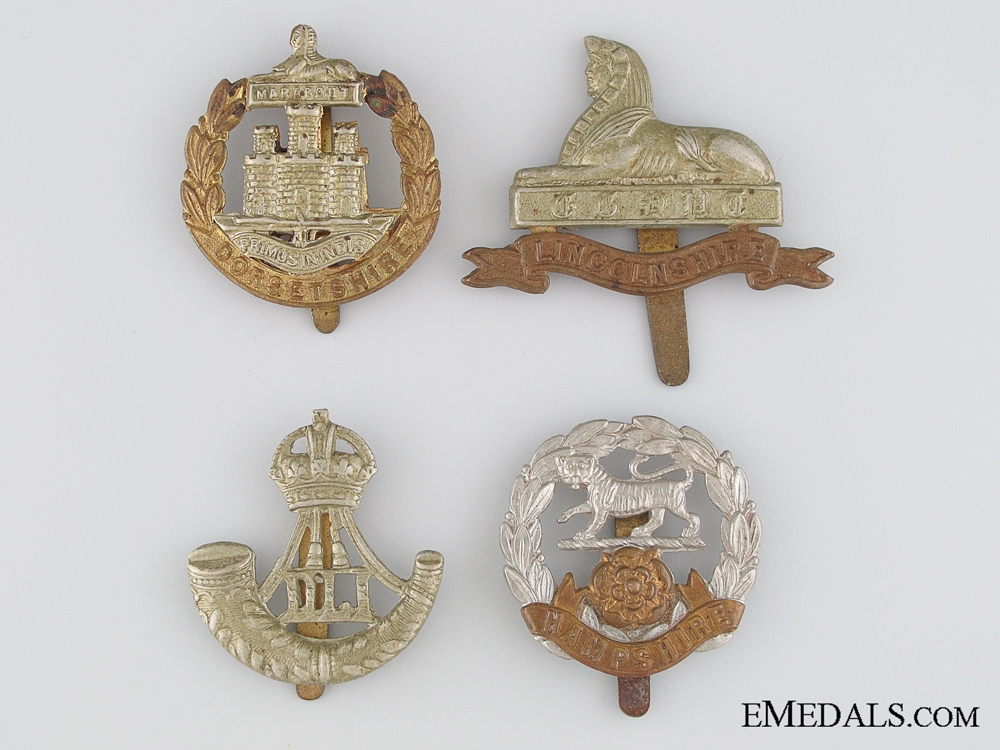 eMedals-Four First & Second War British Cap Badges