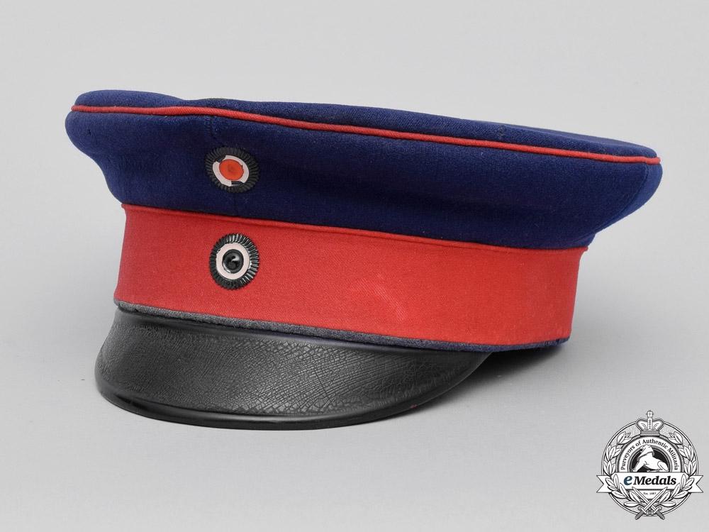 eMedals-Prussia. A Regiment 64, 11th Komp. Visor by Carl Rauschke, Named, c.1915
