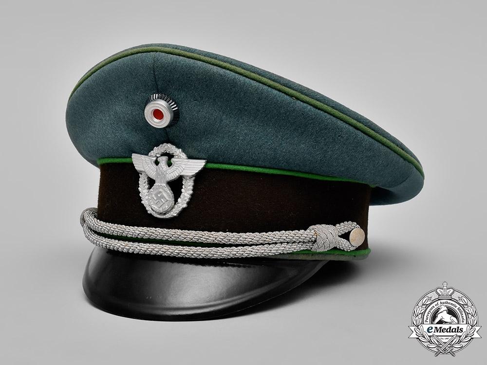 eMedals-Germany, Ordnungspolizei. A Schutzpolizei (Protection Police) Officer's Visor Cap by Hans Pöllmann