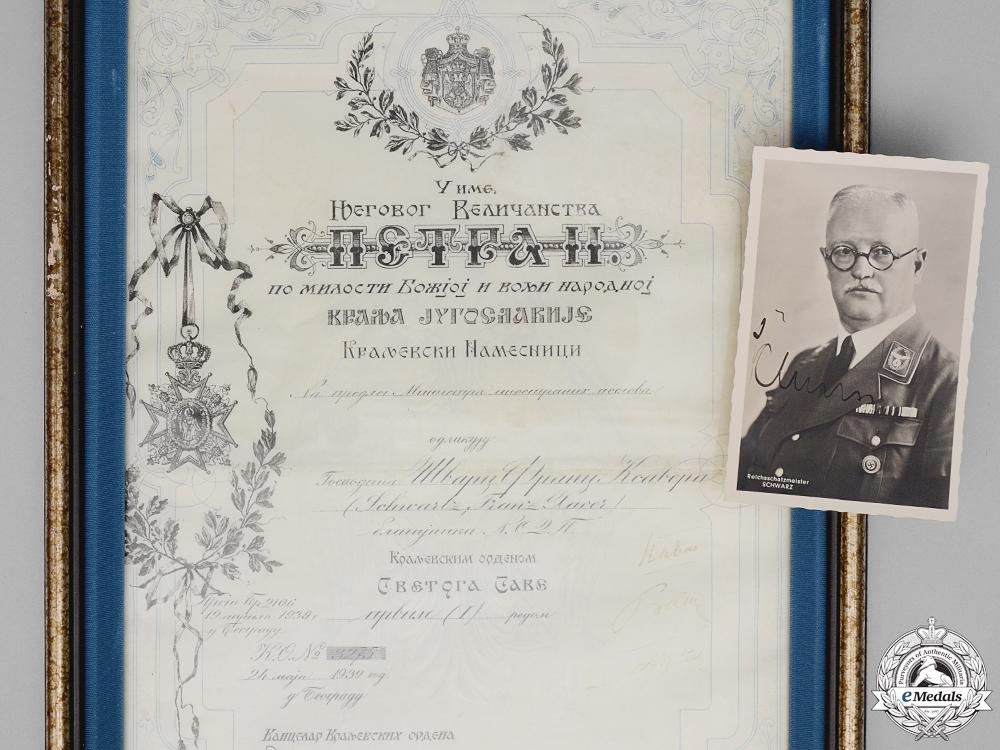 """eMedals-A Yugoslavian St. Sava Award Document to NSDAP Reichsschatzmeister Franz Xaver Schwarz; Party Member Number """"6"""""""