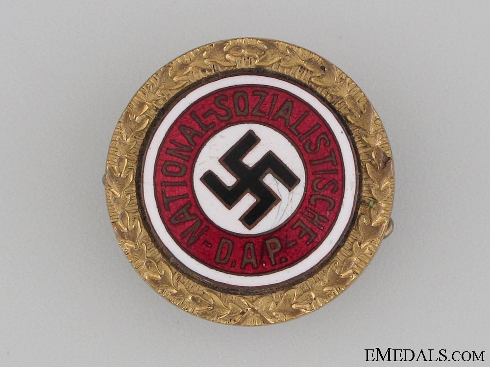 eMedals-A Small NSDAP Golden Party Badge to SS Lieutenant