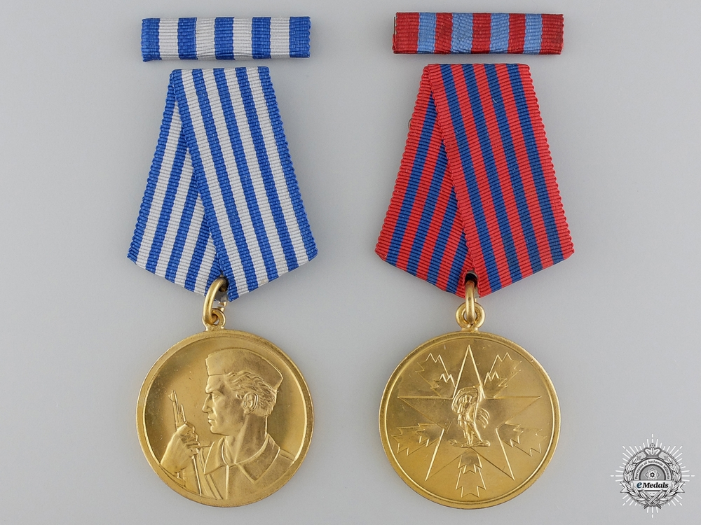 eMedals-Two Mint Yugoslavian Medals in Packets of Issue