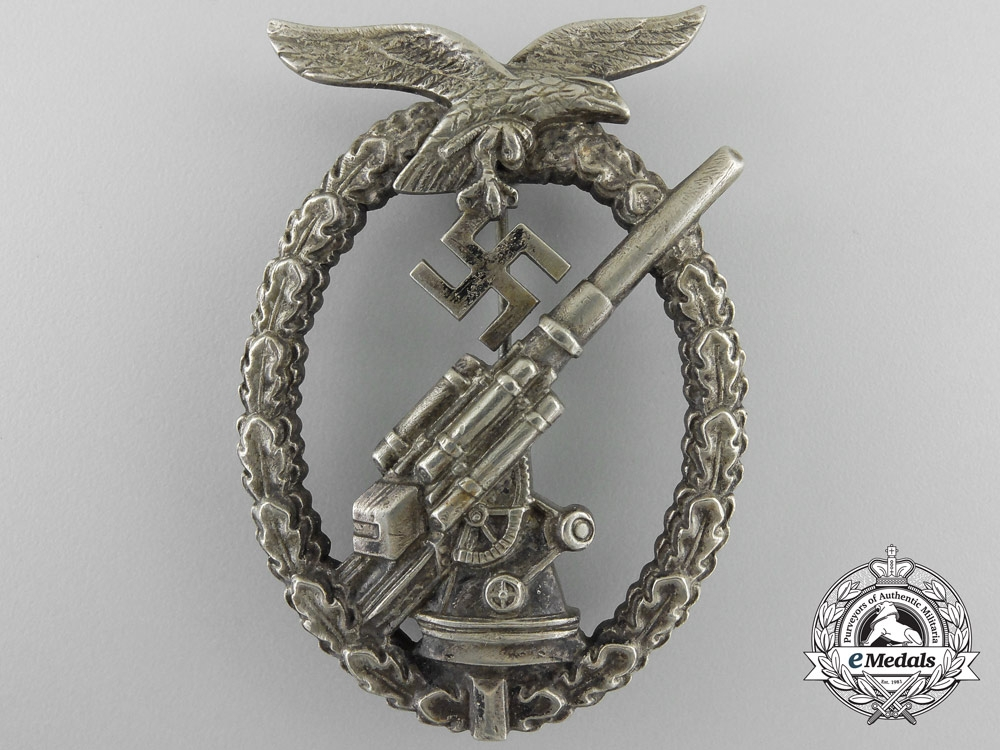 eMedals-An Early Luftwaffe Flak Badge in Tombac with Ball Hinge