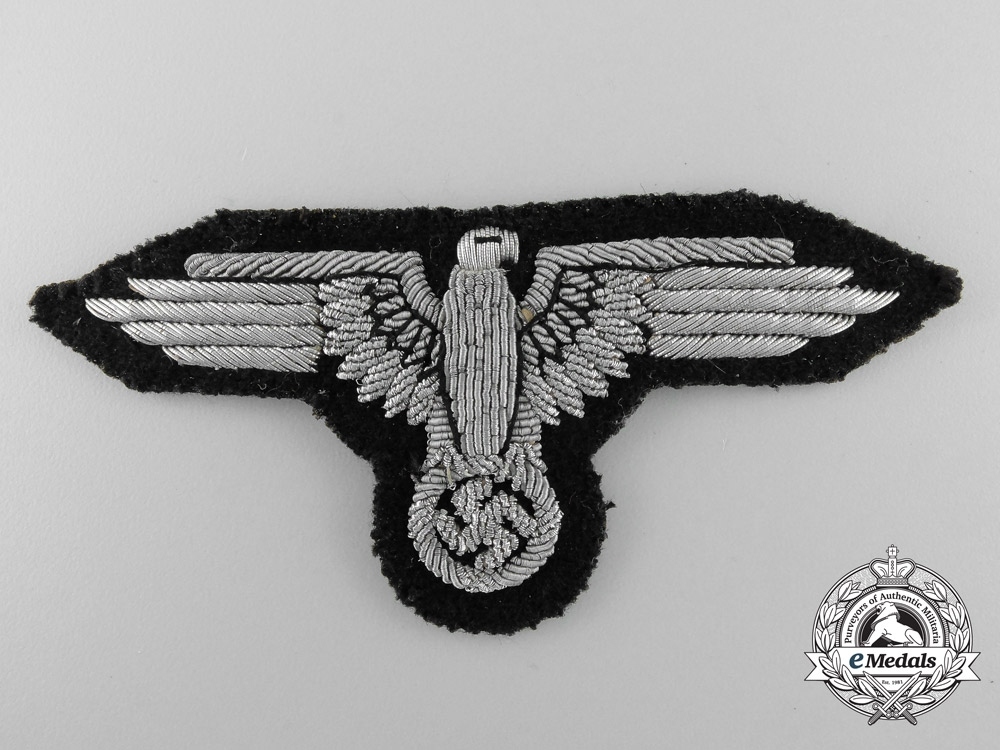 eMedals-Germany. An RZM Type SS-Officer's Arm Eagle; Tunic Removed