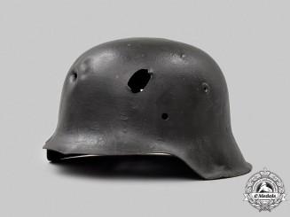 Germany, Heer. A Battle-Damaged M42 Stahlhelm