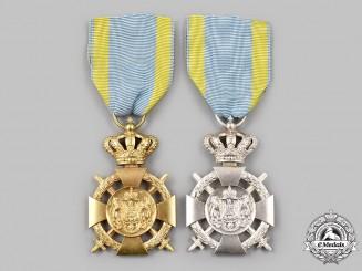 Romania, Kingdom. Two Loyal Service Crosses with Swords, Type II (1932-1947)