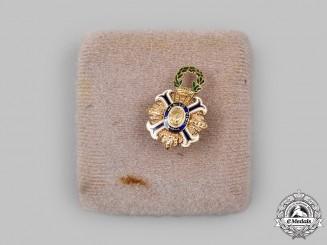 Spain, Fascist State. An Order of Civil Merit, Lapel Badge in Gold