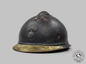 France, III Republic. An M1915 Adrian Infantry Helmet with Veteran's Plate