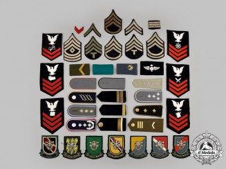 United States, International. A Lot of Thirty-Nine Military Themed Items