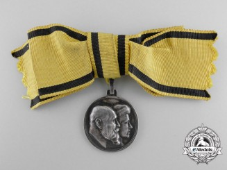 A 1911 Württemberg Anniversary Medal; Ladies Version