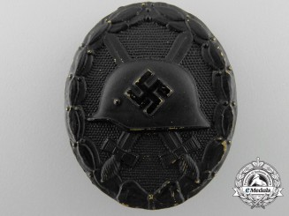 A Black Grade Wound Badge by Wilhelm Deumer