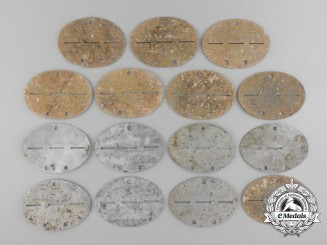 Fifteen Second World War Ground Found Identification Tags