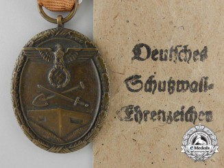 A West Wall Medal with Packet