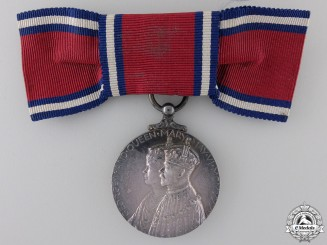A 1935 Jubilee Medal; Ladies Bow