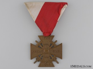 A 1939-1945 Veteran Stahlhelm Iron Cross with Swords for Combat