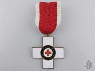 A 1st Model German Red Cross Honour Badge; 2nd Class