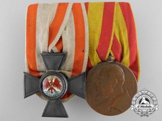 A German Imperial Red Eagle Medal Bar by Neuhaus & Son, Berlin