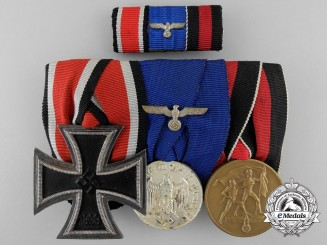 A Wehrmacht Army Second War Medal Bar with Iron Cross Round 3