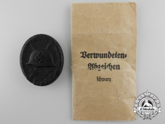 A Mint Black Grade Wound Badge with Packet of Issue