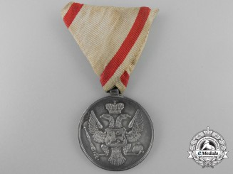 A Montenegrin Silver Bravery Medal by V. Mayer of Vienna