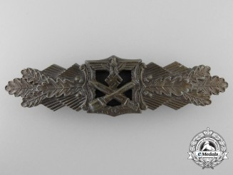 A Mint Bronze Grade Close Combat Clasp by A.G.M.u.K.
