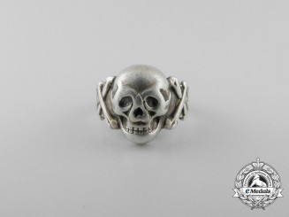 A German Silver Skull Ring; 800 marked