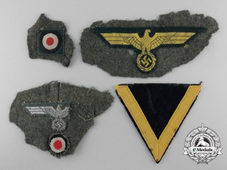 A Lot of Four Second War German Uniform Removed Insignia
