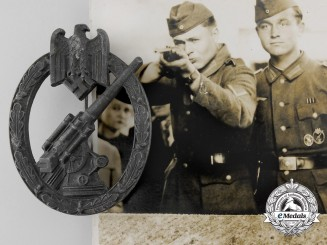 A German Army Flak Badge by Juncker with Recipient Postcard