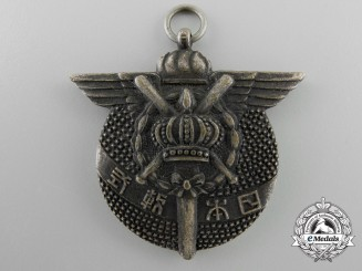 An Imperial Japanese Silver Baseball League Medal
