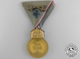 A Hungarian Signum Laudis Medal; Gold Grade