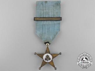 A Gold Grade Belgian Congo Service Star; First Class