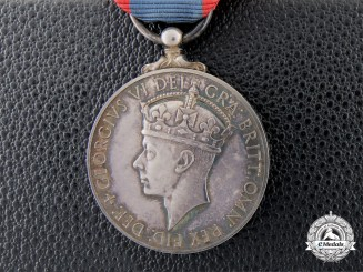 An Imperial Service Medal to Locomotive Engineer Joseph Etienne Roy