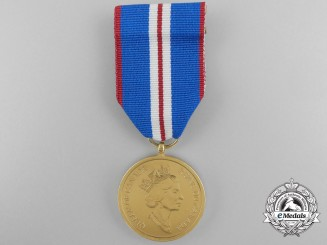 A Queen Elizabeth II Golden Jubilee Medal 2002; Named to a C.V.O.