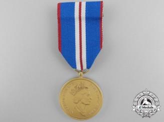 A Queen Elizabeth II Golden Jubilee Medal 2002; Named to a C.V.O.