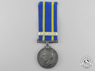 A Royal Canadian Mounted Police Long Service Medal with Three Star Clasp