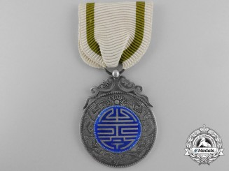China, Qing Dynasty. A Crown Prince Royal Birth Blessing Medal, c.1840