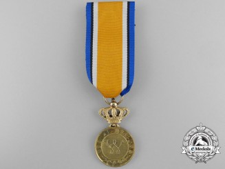 A Dutch Order of Orange-Nassau; Gold Grade Medal