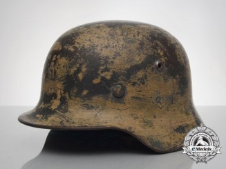 An M35 Single Decal Army (Heer) Afrika Korps Camo Helmet