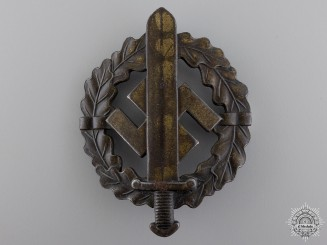 A Bronze Grade SA Defense Badge