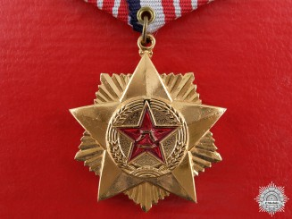 A Chinese Meritorious Service Medal; Third Class