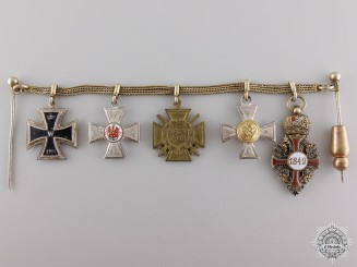 A First War German Red Eagle Chain of Miniatures