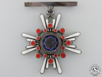A Japanese Order of the Sacred Treasure; Ladies 3rd Class Badge