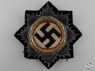 A Kriegsmarine German Cross in Gold, Cloth Version