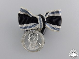 A Miniature Bavarian Silver Military Merit Medal