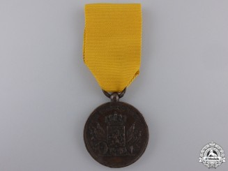 A Pre-1928 Dutch Army Long Service Medal; Bronze Grade