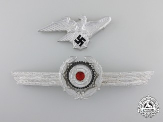 A Reichs Luftschutz Bund Visor Wreath and Eagle